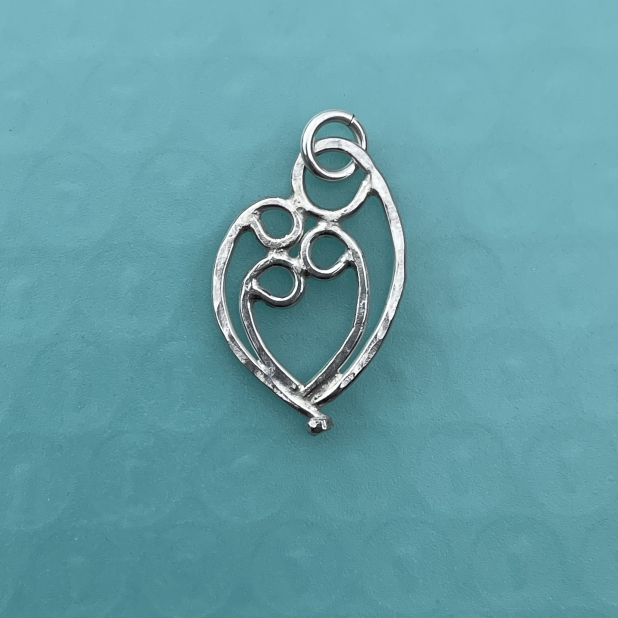 Mother & 3 child pendant, sterling silver.