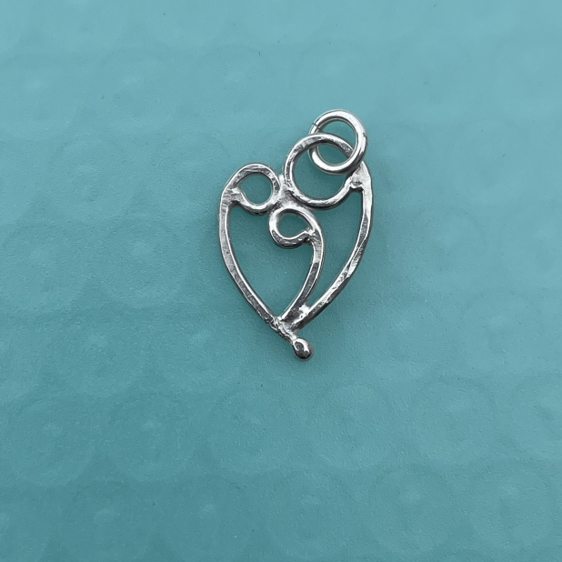 Mother & 2 child pendant, sterling silver.