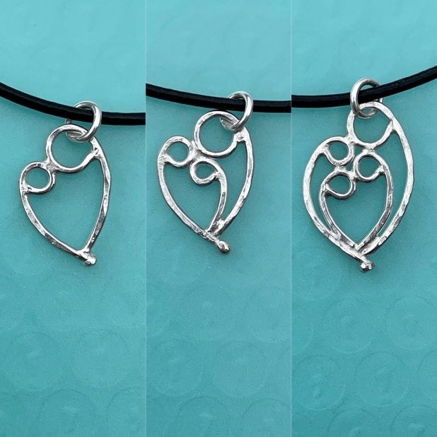 Mother & 1, 2, or 3 child pendant on black cord necklace.