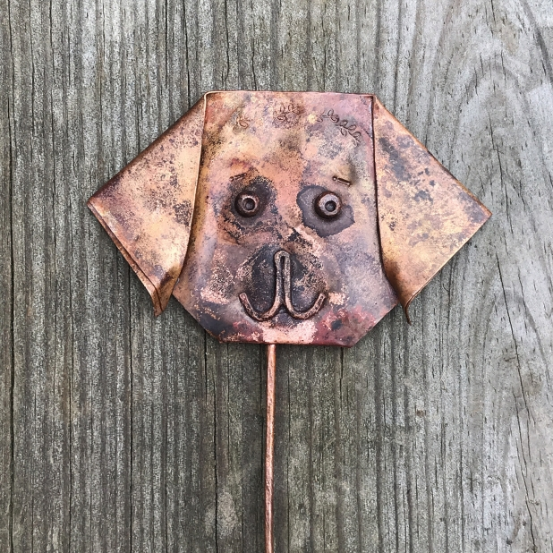Origami puppy dog face, plant decoration