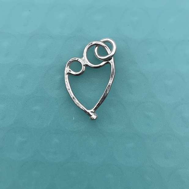 Mother & 1 child pendant, sterling silver.