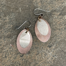 Mixed metal textured ovals earrings.