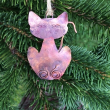 Copper cat ornament.