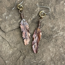 Copper feather earrings, view 1